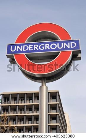 LONDON - APRIL 10, 2016. A freestanding London Transport underground railway sign at King's Cross St Pancras station, London, UK. - stock photo