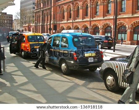 LONDON - APRIL 29 : A London Taxi or 'Black Cab' at St. Pancras Int'l on April 29, 2013 in London, UK. All London cabs undergo a strict annual mechanical test before they are allowed to ply for hire. - stock photo
