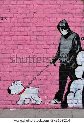 LONDON - APRIL 11, 2015. A painting on a brick wall at Hanbury Street, Shoreditch in the Borough of Tower Hamlets, an area renown for its street art in east London, UK. - stock photo