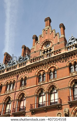 LONDON � APRIL 10. 2016. Architectural detail of the restored 1868 Victorian Gothic style St Pancras railway station and hotel designed by Sir George Gilbert Scott, located in London, UK. - stock photo