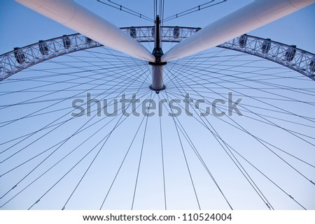LONDON - APRIL 14: Architecture of London Eye, on April 14, 2012 in London. The largest Ferris wheel in Europe, structure of the London Eye is 135 M. tall and the wheel has a diameter of 120 M. - stock photo