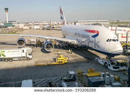 LONDON - APRIL 11, 2014: British Airways Airbus A380 in Heathrow airport. British Airways if the flag carrier airline of the United Kingdom, operating 256 aircrafts - stock photo