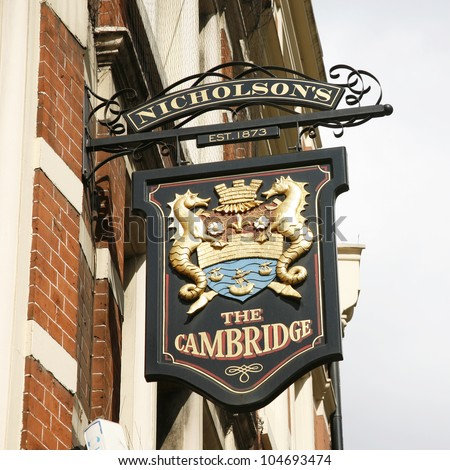 LONDON - APRIL 15: English pub sign, Public house, known as pub, is focal point of community, on April 15, 2012, London, UK. Pub business, now about 53,500 pubs in UK, has been declining every year - stock photo
