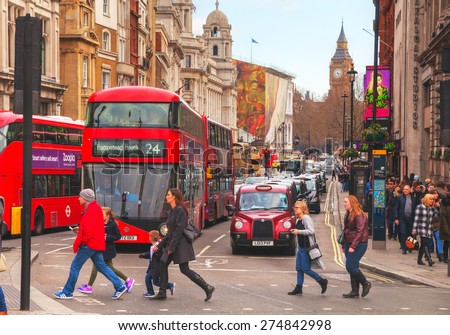 LONDON - APRIL 5: Iconic red double decker bus on April 5, 2015 in London, UK. The London Bus is one of London's principal icons, the archetypal red rear-entrance Routemaster recognised worldwide. - stock photo