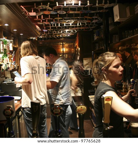 LONDON - APRIL 13: Inside view of pub, for drinking and socializing, focal point of community, on April 13, 2006, London, UK. Pub business, now about 53,500 pubs in UK, has been declining every year - stock photo