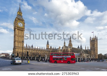LONDON - APRIL 12: London Bus with Big Ben on April 12, 2015 in London, England. The London Bus service is one of the largest urban bus networks in the world with 8,000 buses covering 700 routes.
