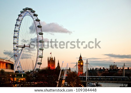 LONDON - APRIL 15: London Eye with Big ben, on April 15, 2012 in London. The largest Ferris wheel in Europe, structure of the London Eye is 135 M. tall and the wheel has a diameter of 120 M. - stock photo