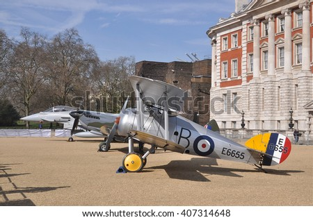 LONDON - APRIL 1, 2016. Museum examples of vintage aircraft; a Sopwith Snipe, Spitfire and Eurofighter Typhoon, briefly on public display by the Old Admiralty Building, Horse Guard's Parade, London.