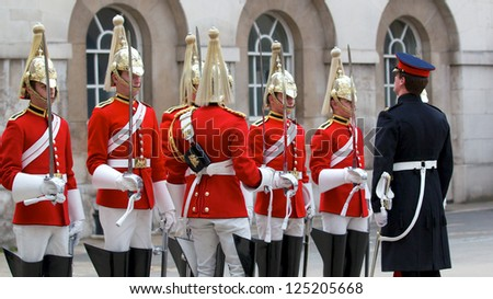LONDON - APRIL 13: Official inspect the guards during the changing of the guard in Buckingham Palace, April 13, London 2011, England - stock photo