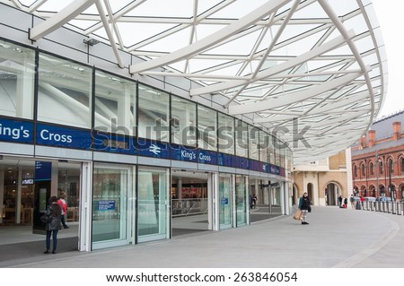 LONDON - APRIL 13: People entering King's Cross railway station. The annual rail passenger usage between 2011 - 2012 was 27.874 million. - stock photo