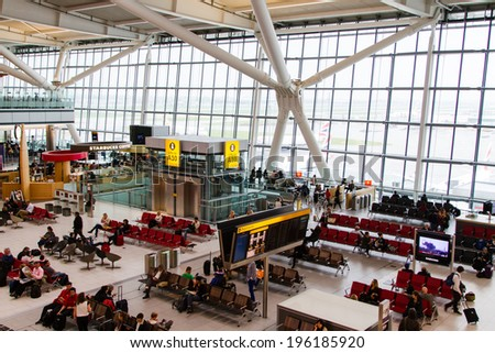 LONDON - APRIL 20: People in waiting room at Heathrow airport on April 20, 2013 in London, England. Heathrow is one of largest world airports. - stock photo