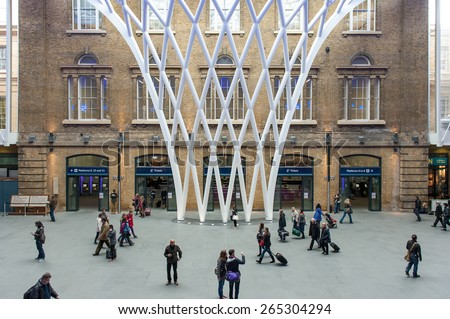 LONDON - APRIL 13, 2013: People inside King's Cross railway station. The annual rail passenger usage between 2011 - 2012 was 27.874 million. - stock photo