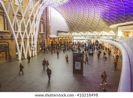 LONDON - APRIL 18, 2016: People inside King's Cross railway station. The annual rail passenger usage between 2011 - 2012 was 27.874 million. - stock photo