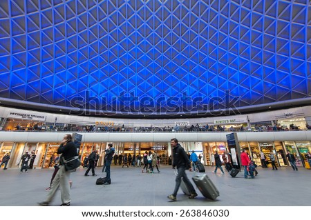 LONDON - APRIL 13, 2013: People walking inside King's Cross railway station. The annual rail passenger usage between 2011 - 2012 was 27.874 million. - stock photo