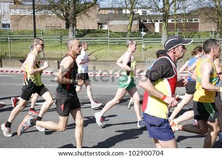 LONDON - APRIL 22: Runners in the London Marathon on April, 22, 2012 in London, UK. The London Marathon is next to New York, Berlin, Chicago and Boston to the World Marathon Majors, Champions League - stock photo