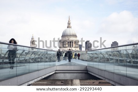 LONDON - APRIL 6, 2015: St. Paul's cathedral from the Millenium bridge - stock photo