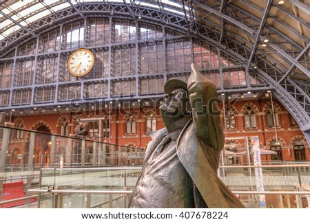LONDON - APRIL 18, 2016. Standing in the restored and redeveloped St Pancras International rail station is a statue of Sir John Betjeman who saved the building from demolition - stock photo