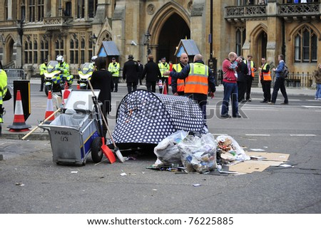 LONDON - APRIL 29 - Street cleaners clear up after overnight campers for the Royal Wedding of Prince William and Kate Middleton April 29, 2011 at Westminster Abbey in London, England. - stock photo
