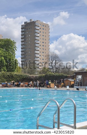 LONDON - APRIL 30, 2016. The annual Art Deco and mid century collectors fair surrounds the 1937 Brockwell Lido pool, overlooked by 20th century apartment blocks in the Borough of Lambeth, London. - stock photo