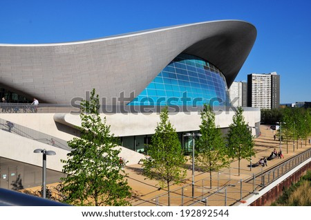 LONDON - APRIL 16. The Aquatics Centre at the new Queen Elizabeth Olympic Park on April 16, 2014, designed by Zaha Hadid Architects and now open to the public at Stratford, London, UK. - stock photo