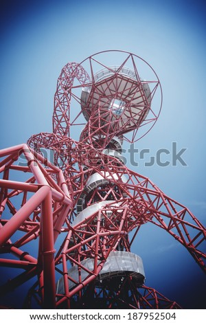 LONDON - APRIL 5. The Arcelor Mittal Orbit from the Olympic Games, designed by Anish Kapoor and Cecil Balmond. Queen Elizabeth Olympic Park April 5, 2014, opening day of the new public area London, UK - stock photo
