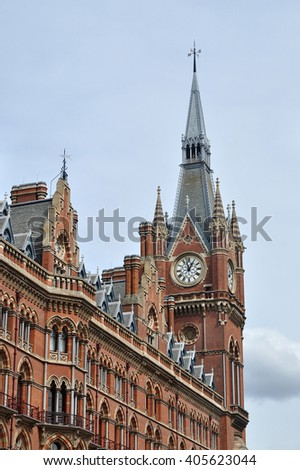 LONDON - APRIL 10. 2016. The clock tower of the restored 1868 Victorian Gothic style St Pancras railway station and hotel designed by Sir George Gilbert Scott, located in London, UK. - stock photo