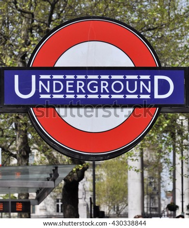 LONDON - APRIL 20, 2016. The early 20th century version of the London Transport Underground Railway logo at the Trafalgar Square entrance to Charing Cross station in central London, UK. - stock photo