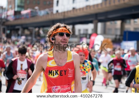 LONDON - April 24 2016. The London Marathon. Man looking visibly exhausted at the 17 mile mark in the London Marathon - stock photo