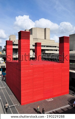 LONDON - APRIL 26. 'The Shed' is the National Theatre's temporary red timber venue celebrating performences that are adventurous, ambitious and unexpected on April 26, 2014 at the South Bank, London. - stock photo