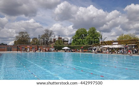 LONDON - APRIL 30, 2016. The stalls of the annual Art Deco and mid century collectors' fair surround the Brockwell Lido pool, built in 1937, in the Borough of Lambeth, London, UK. - stock photo