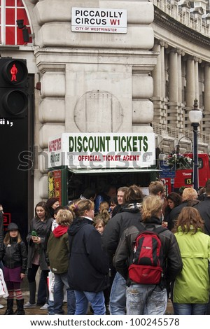 LONDON - APRIL 1: Tourists in Piccadilly Circus, famous tourist attraction, road junction, built in 1819, links to West End, Regent Street, Haymarket, Leicester Square, on April 1, 2010 in London, UK - stock photo