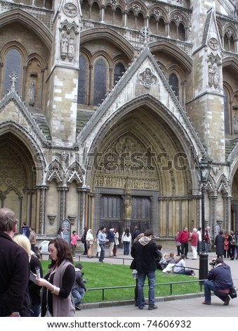 LONDON- APRIL 2: Tourists visit Westminster abbey, the venue for the royal wedding of prince William and Kate Middleton to be held later this month in London, April 2, 2011. - stock photo