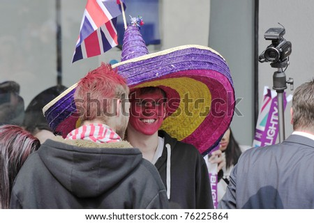 LONDON - APRIL 29 - Unidentified members of the public celebrate the Royal Wedding of Prince William and Kate Middleton on April 29, 2011 at Westminster Abbey, London, England. - stock photo