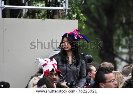 LONDON - APRIL 29 - Unidentified members of the public celebrate the Royal Wedding of Prince William and Kate Middleton on April 29, 2011 at Westminster Abbey in London, England. - stock photo