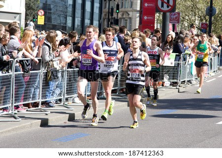 LONDON - APRIL 13: Unidentified men run the London marathon on April 13, 2014 in London, England, UK. The marathon is an annual event.