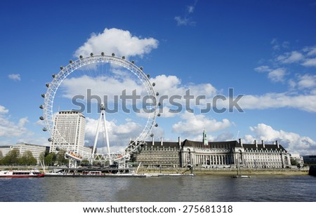 LONDON - APRIL 29 : View of The London Eye on April 29, 2015 in London, UK. A famous tourist attraction at a height of 135 metres (443 ft) and the biggest Ferris wheel in Europe. 