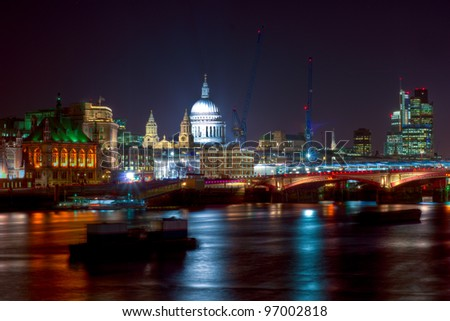 London at Night - a view across the Thames towards St Paul - stock photo