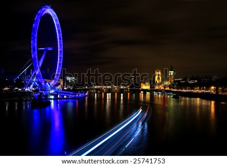 London at Night with Millennium Wheel, River Thames and Boats - stock photo