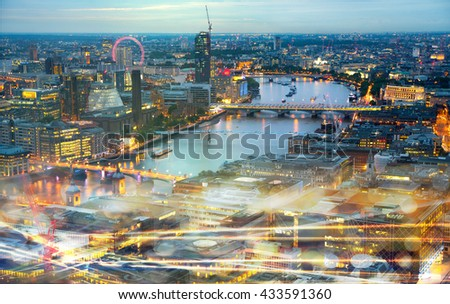 London at sunset, river Thames and traffic lights effect. Modern life concept - stock photo