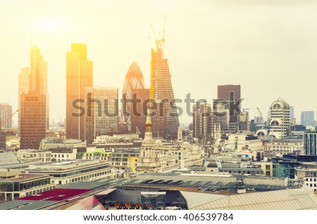 London At Sunset, yellow sun light over London City Center - View on business modern district and Canary Wharf at the background. - stock photo