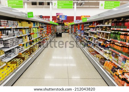 LONDON - AUG 18: Aisle view of an Asda supermarket on Aug 18, 2014 in London, UK. Founded in 1949 Asda is the UK's third largest retail chain with 568 stores and an operating income of �£638 million. - stock photo