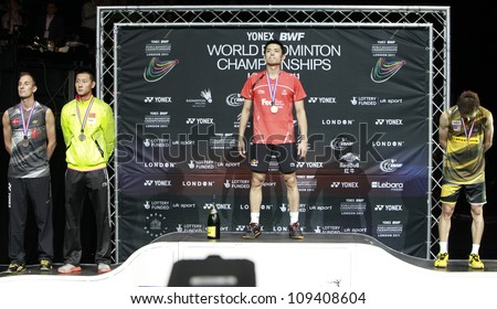 LONDON AUG 14: China's Lin Dan (2R) on the podium after defeating Malaysia's Lee Chong Wei (R) in the men's singles final of the World Badminton Championships at Wembley Arena in London, Aug 14, 2011. - stock photo