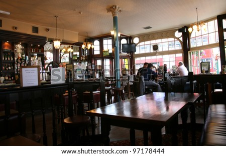 LONDON - AUG 3: Interior of pub, for drinking and socializing, focal point of the community, on Aug 3, 2010, London, UK. Pub business, now about 53,500 pubs in the UK, has been declining every year - stock photo
