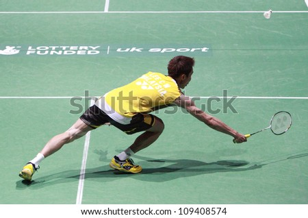 LONDON AUG 14: Lee Chong Wei of Malaysia dives for a shot during the men's singles final against China's Lin Dan at the World Badminton Championships at Wembley Arena in London on August 14, 2011. - stock photo
