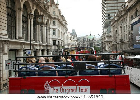 LONDON - AUG 12: London Sightseeing bus on Aug 12, 2010, London, UK. Open-top tour bus with audio guide, various languages available, is the great way see the London's major sights in short time. - stock photo
