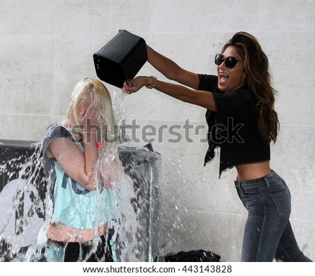 LONDON - AUG 26, 2014: Nicole Scherzinger takes part in the Ice bucket challenge at the BBC on Aug 26, 2014 in London