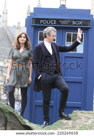 LONDON - AUG 22: Peter Capaldi and Jenna Coleman promoting the new BBC series of 'Dr Who' in Parliament Square on 22, Aug, 2014 in London  - stock photo