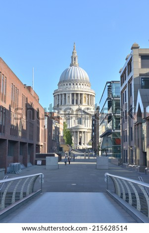 LONDON -  AUG 31, 2014: St. Paul's cathedral from the millenium bridge - stock photo