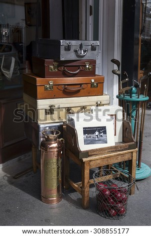 LONDON - AUG 16:  Suitcases near vintage shop at Portobello Market, in Notting Hill district, largest antiques market in UK, famous tourist attractions, on AUG 16, 2015, London, UK.