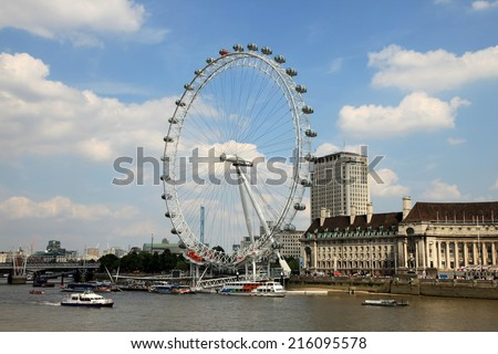 LONDON - AUG 9 : The London Eye during one of the warmest summer's in recent years on August 9, 2012 in London, UK. - stock photo